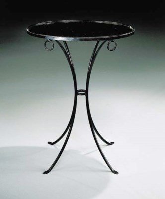 A Black Lacquered Metal Guerid