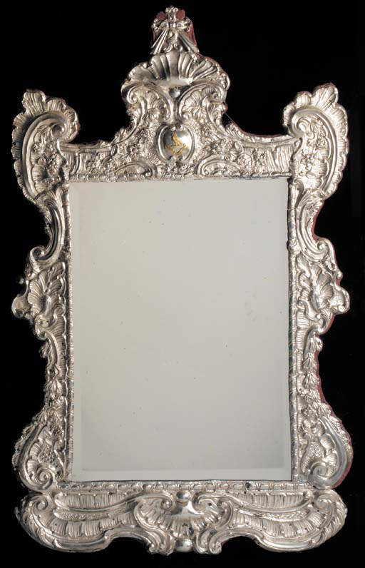 A SILVER REPOUSSEE FRAMED MIRR