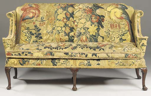 A TAPESTRY-COVERED ASH SOFA