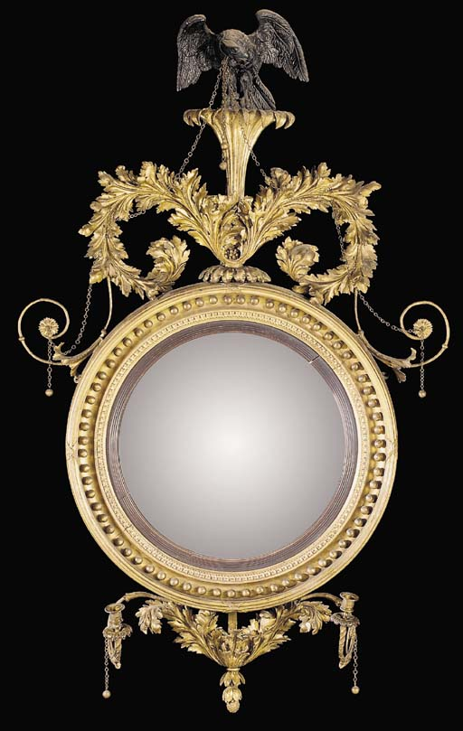 A REGENCY GILTWOOD AND EBONISED CONVEX TWO-LIGHT MIRROR