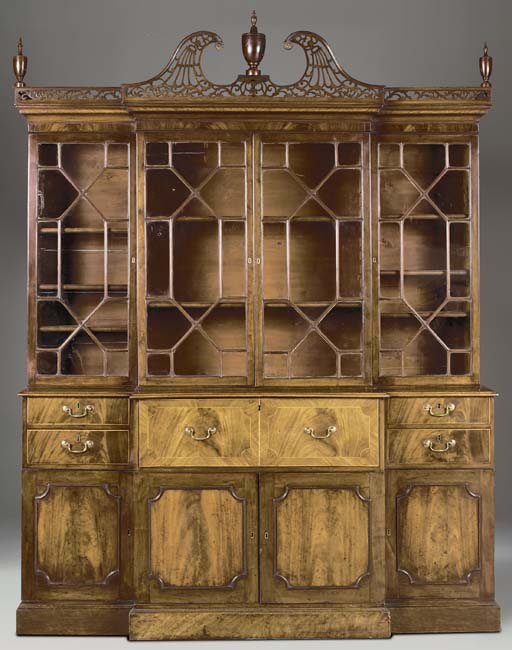 A GEORGE III MAHOGANY BREAKFRONT SECRETAIRE-BOOKCASE
