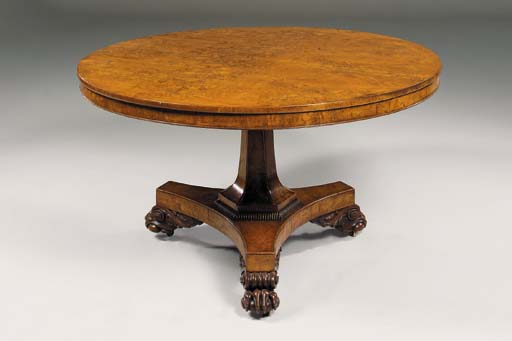 A REGENCY OAK CENTRE TABLE
