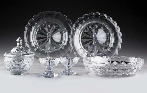 A cut-glass bowl and a cover;