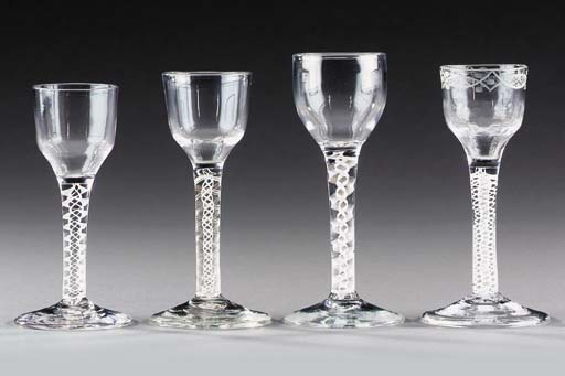 Four wine-glasses with opaque-