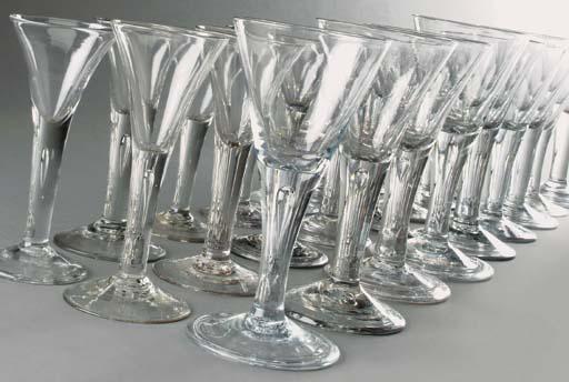 Four large drawn-trumpet wine-