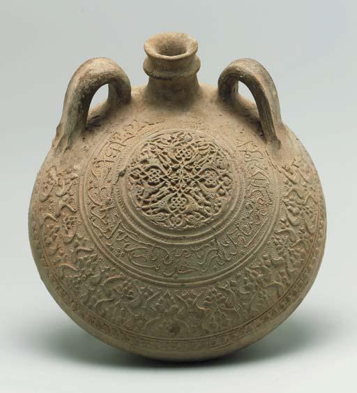 an ilkhanid large unglazed pottery pilgrim flask probably north