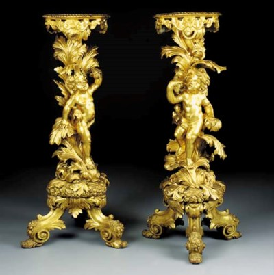 A pair of English giltwood sta