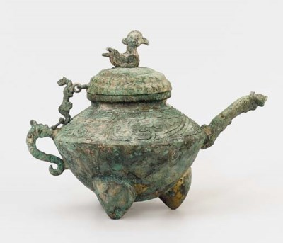 A BRONZE TRIPOD EWER AND COVER