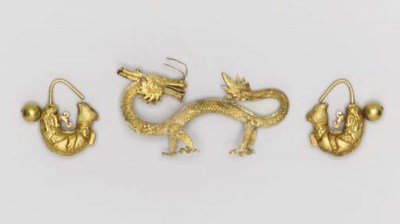 A GOLD DRAGON AND A PAIR OF GO