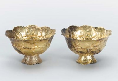A PAIR OF GILT REPOUSSE SILVER
