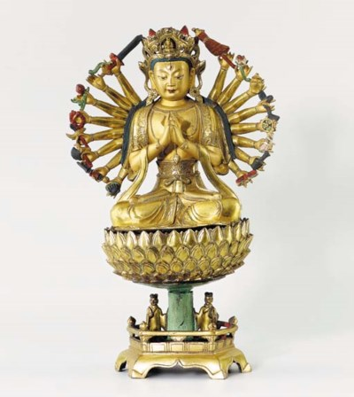 A GILT-BRONZE FIGURE OF GUANYI