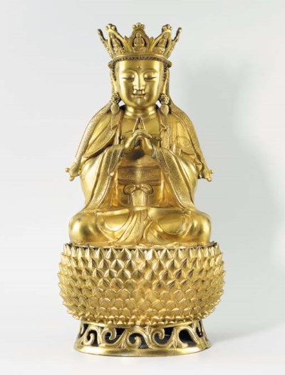 A FINE GILT-BRONZE FIGURE OF A