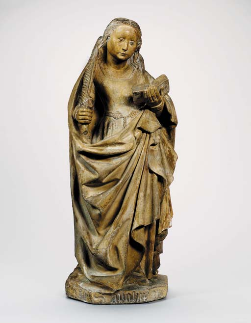 A CARVED STONE FIGURE OF ST. B