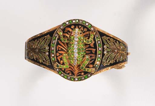An antique demantoid garnet and diamond bangle