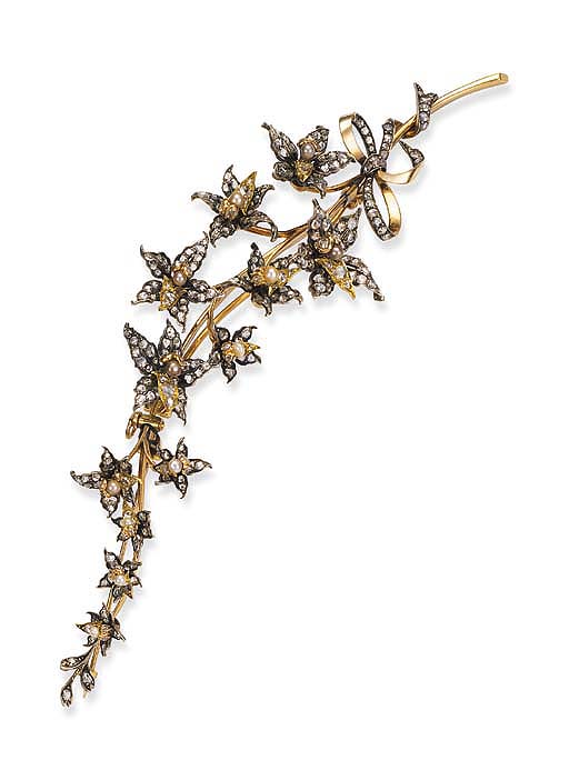 An antique diamond and pearl spray brooch