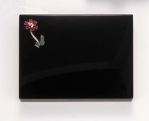 A black enamel and gem-set vanity case, by Cartier