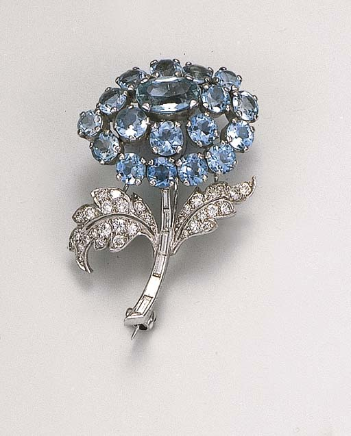 An aquamarine and diamond spray brooch, by Cartier