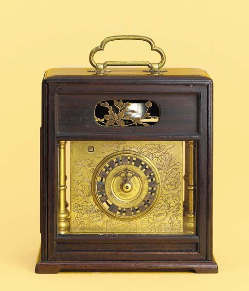 A Japanese gilt-brass and hard