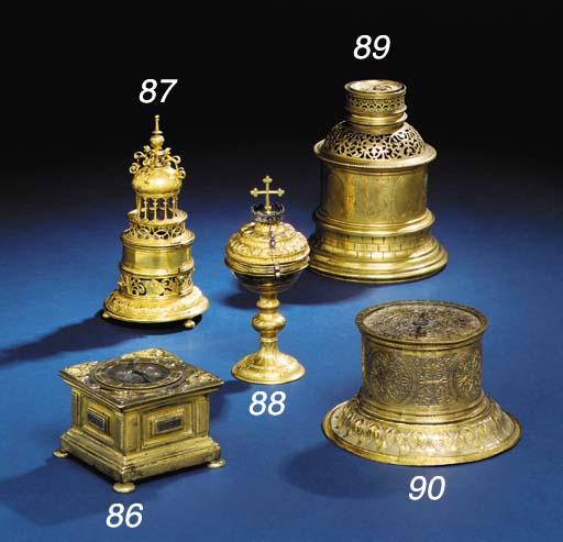 A brass table clock