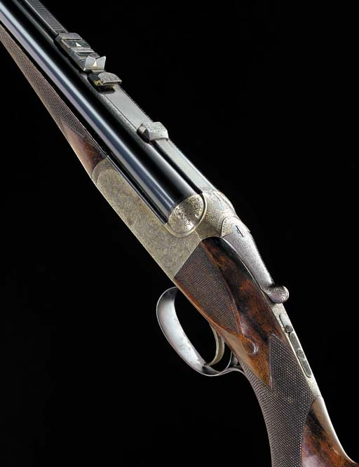 AN UNUSUAL .450/.400 (2 3/8IN. NITRO EXPRESS) DOUBLE-BARRELLED HAMMERLESS SINGLE-TRIGGER DETACHABLE-BOXLOCK EJECTOR RIFLE BY WESTLEY RICHARDS, NO. 16272
