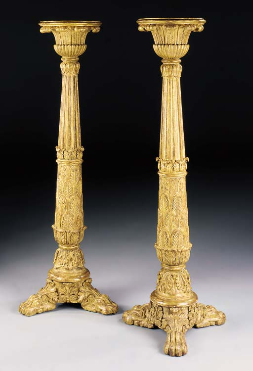 A PAIR OF REGENCY GILTWOOD TORCHERES