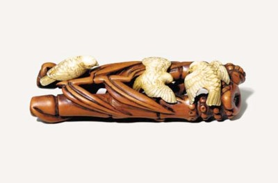 An Ivory and Boxwood Netsuke