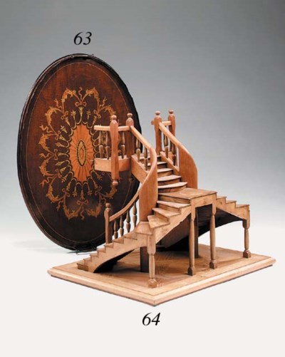 A carved mahogany model of a s