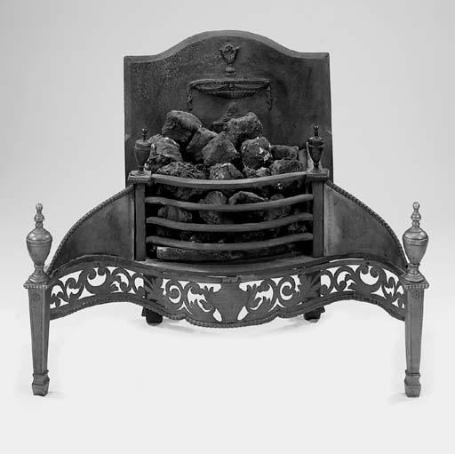 A cast iron and brass fire gra