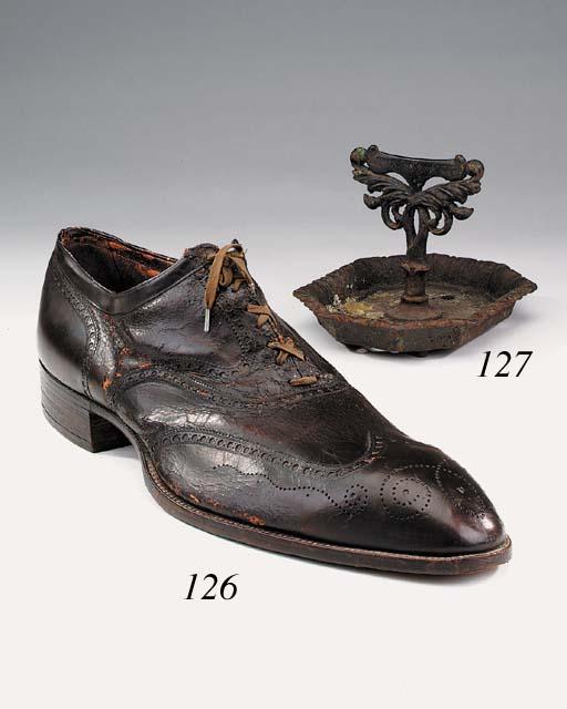A Regency cast iron shoescrape