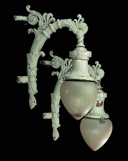 A pair of large cast iron exterior wall lights, first half 20th century