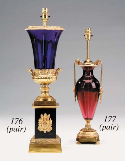 A pair of blue glass and gilt