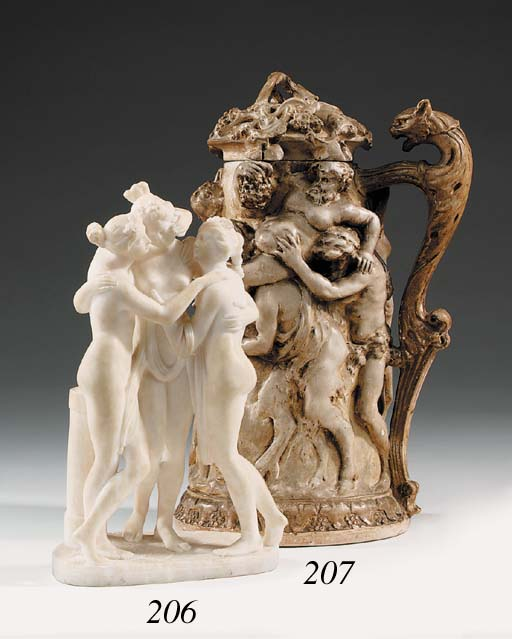 A carved alabaster figure grou