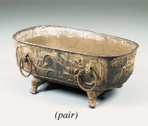 A pair of cast iron jardiniere