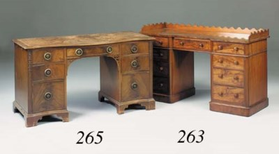 A mahogany serpentine desk, ea