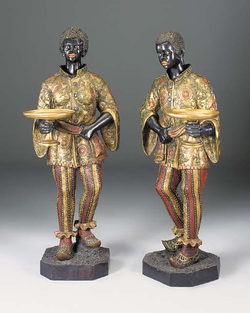 A pair of cast metal and polyc