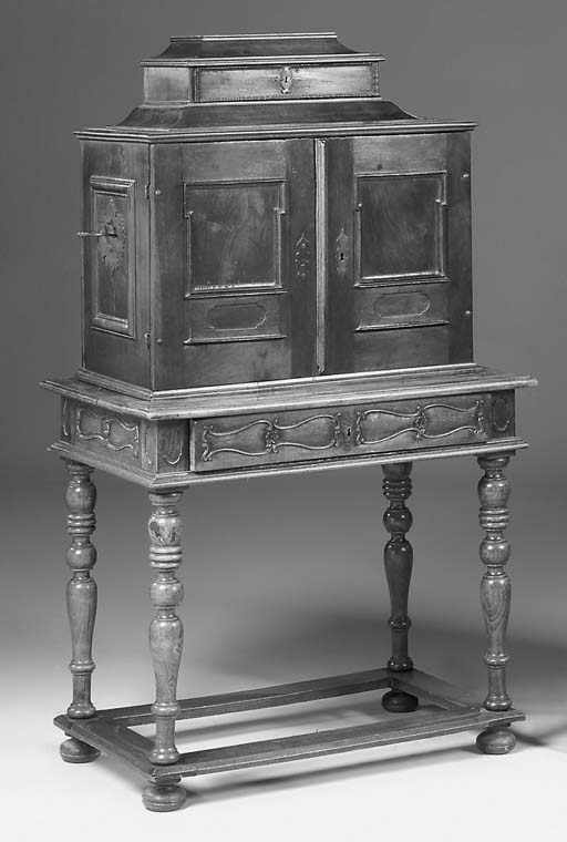 A walnut cabinet on later stan