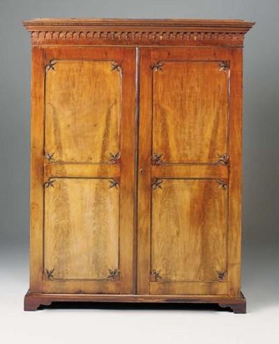 A mahogany wardrobe, early 19t