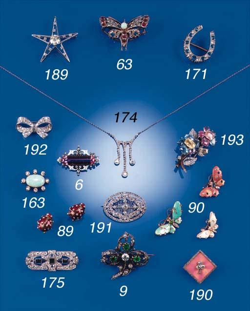 A diamond and sapphire plaque