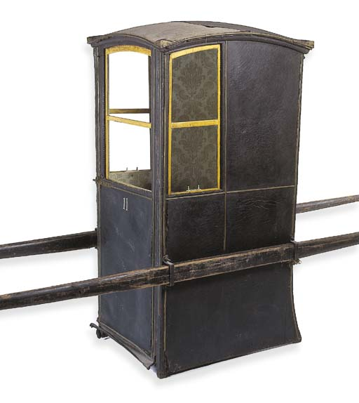 A leather covered sedan chair