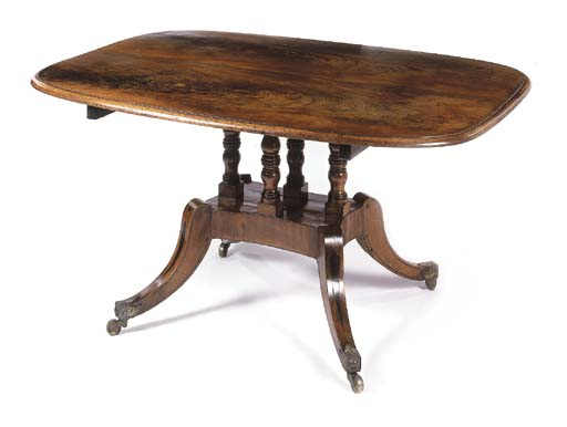 A mahogany breakfast table