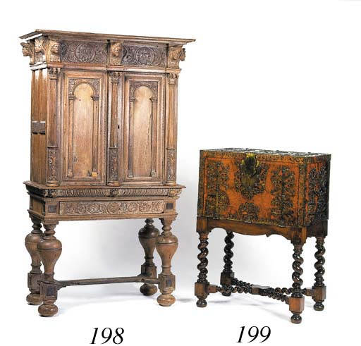 A Flemish limed oak cabinet-on