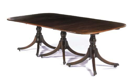 A mahogany triple-pedestal din