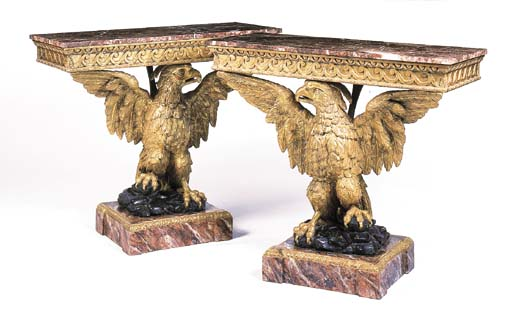 A pair of giltwood eagle conso