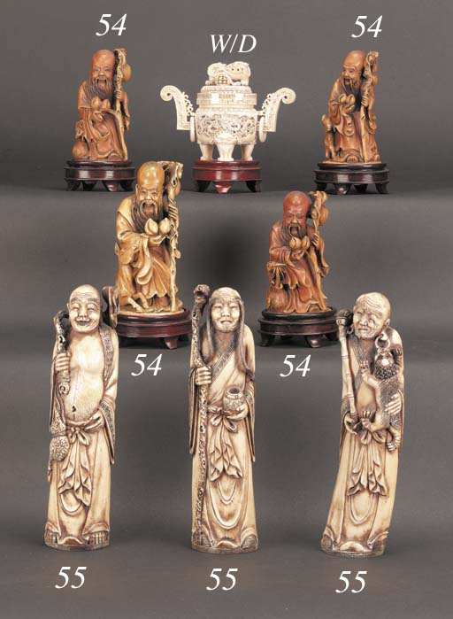 A set of four stained ivory fi