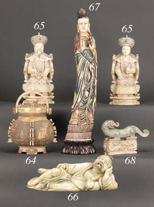 A stained ivory figure of a re