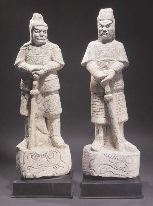 A pair of Ming style stone fig