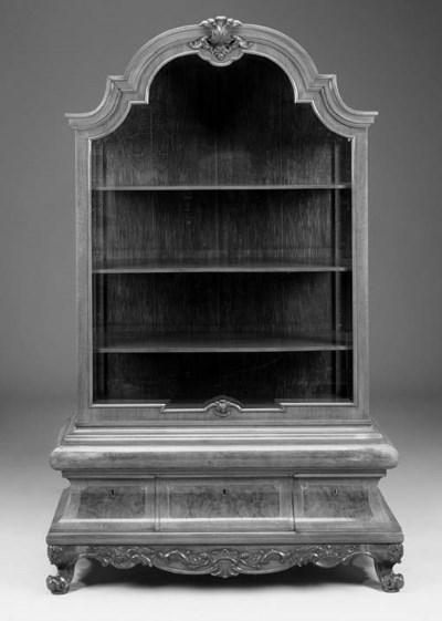 A carved walnut vitrine