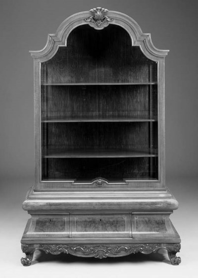 A carved walnut vitrine
