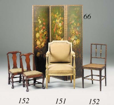 A cream painted open armchair,