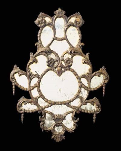 An Italian carved and gilt com